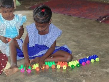 Children too young to help their mothers cook are offered toys and crafts during class time 2.jpg